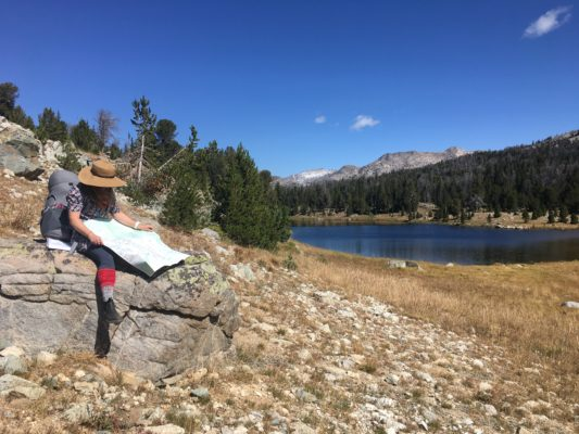 hiker reading map